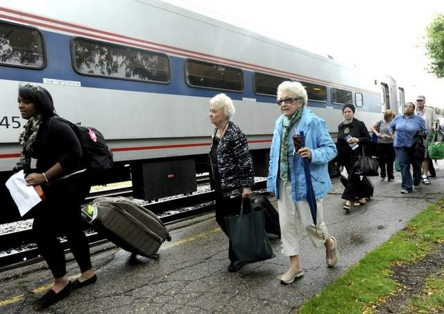 Passengers prepare to board an Amtrak train in East Lansing this month. / Greg DeRuiter/Lansing State Journal