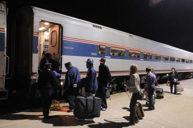 Passengers board the Blue Water train at the Amtrak station in Port Huron. The start of the third phase of a track improvement project will bump the Port Huron westbound train departure time from 6:20 a.m. to 5:20 a.m. / MARK R. RUMMEL/ TIMES HERALD