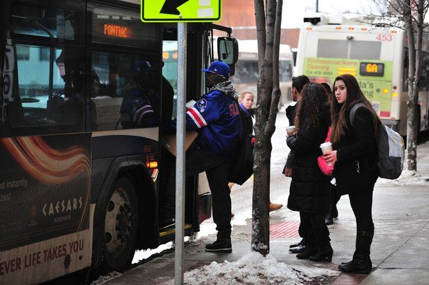 Passengers board an AAATA bus on Fourth Avenue in downtown Ann Arbor on a recent afternoon. (Ryan Stanton | The Ann Arbor News)