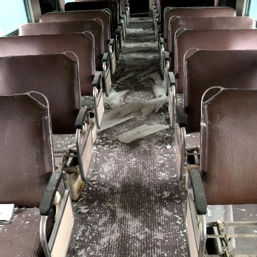 RICK CHARMOLI | CADILLAC NEWS Lights, seats and windows were found broken in the 17 passenger cars on tracks near the corner of North Mitchell Street and 13th Street. The damage was discovered by an employee of Great Lakes Central Railroad.