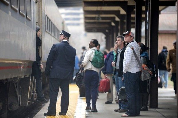 Passengers board an Amtrak train in Ann Arbor. (File photo | The Ann Arbor News)