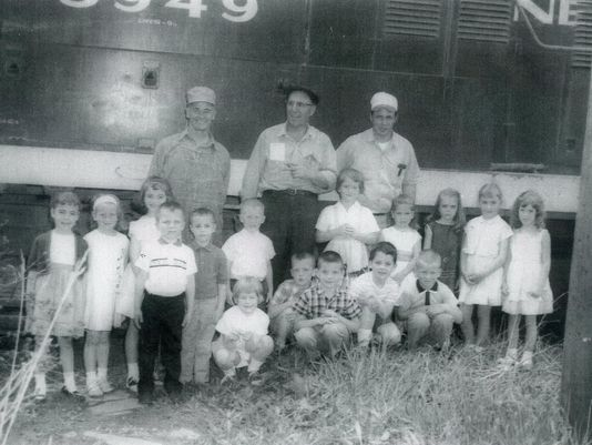 The children in this photo are students in the 1960 kindergarten class of Mrs. James Lingo, Jr. They were visiting railroaders at the Shelby Depot. In the back row, from left, are engineer Richard Hoover of Galion, conductor Bill Hocker of Galion and brakeman Roger Weaver of Ontario.(Photo: Submitted photo)